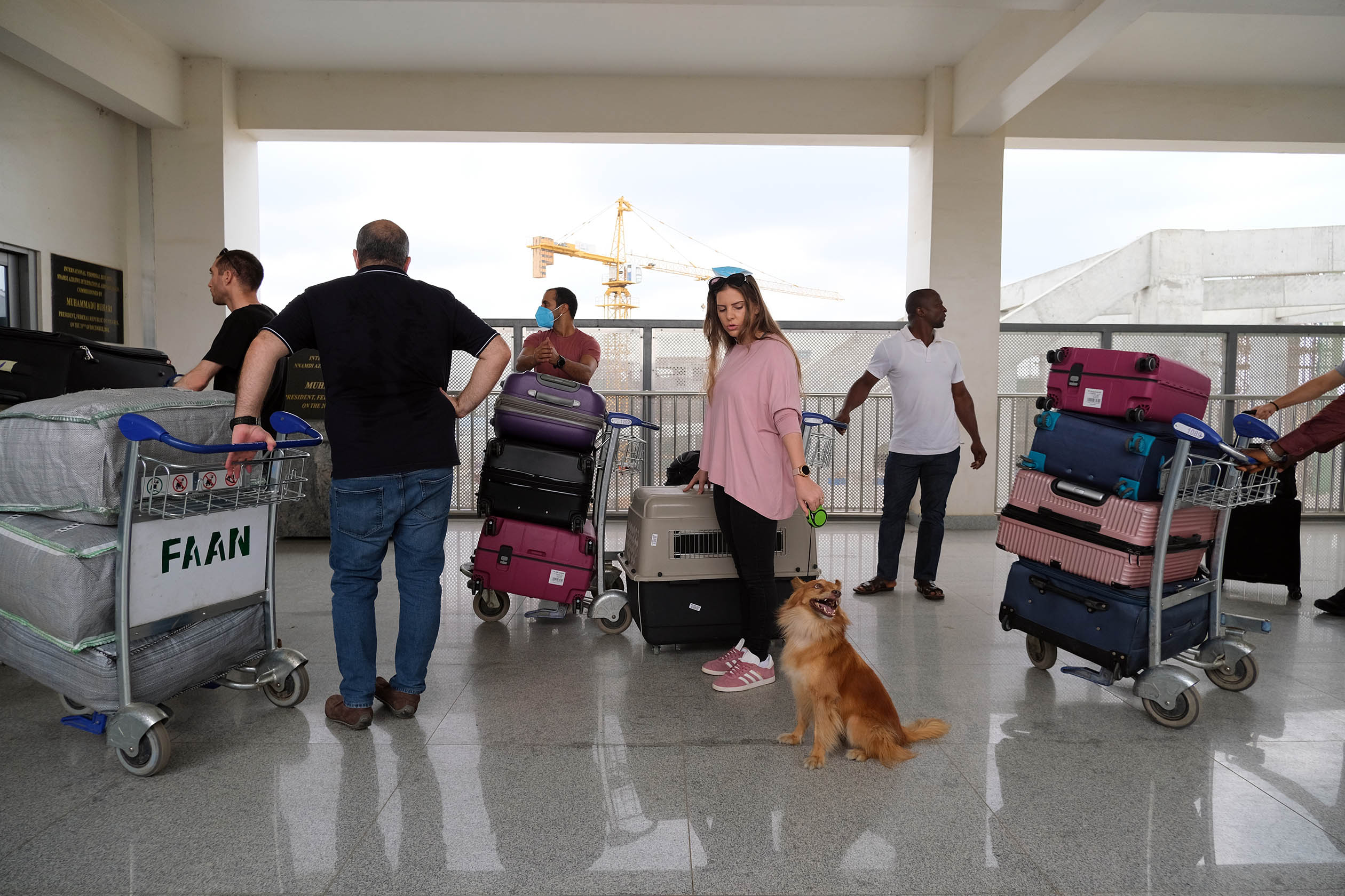 Passengers push their luggage carts during an evacuation of Israeli nationals, as Nigerian authorities try to limit the spread of the coronavirus disease (COVID-19), in Abuja, Nigeria March 29,2020. Photo: Sodiq Adelakun / Channels TV