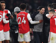 In this file photo taken on January 1, 2020 Arsenal's Spanish head coach Mikel Arteta (C) celebrates with his players on the pitch after the English Premier League football match between Arsenal and Manchester United at the Emirates Stadium in London. Ben STANSALL / AFP