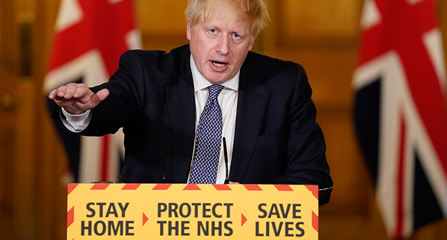 A handout image released by 10 Downing Street, shows Britain's Prime Minister Boris Johnson speaking during a remote press conference to update the nation on the COVID-19 pandemic, inside 10 Downing Street in central London on April 30, 2020. Andrew PARSONS / 10 Downing Street / AFP