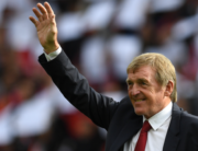 In this file photo Former Liverpool player and manager Kenny Dalglish takes the applause of the supporters a day after having the new grandstand named after him, on the pitch ahead of the English Premier League football match between Liverpool and Manchester United at Anfield in Liverpool, north west England on October 14, 2017. Paul ELLIS / AFP