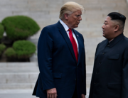 In this file photo taken on June 30, 2019, US President Donald Trump and North Korea's leader Kim Jong-un stand on North Korean soil while walking to South Korea in the Demilitarized Zone(DMZ), in Panmunjom, Korea. Brendan Smialowski / AFP