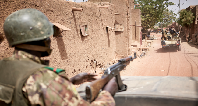 Troops of the Malian army patrol the ancient town of Djenne in central Mali on February 28, 2020. A week earlier Mali's Prime Minister announced the dismantling of the security checkpoints organized by the traditional militia hunters Dan Na Ambassagou from Dogon country. MICHELE CATTANI / AFP