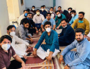 In this handout photograph released by the Young Doctors Association (YDA) Punjab and taken on April 24, 2020, doctors wearing facemasks sit in during a hunger strike protest at the Punjab Health Secretary in Lahore. Handout / YOUNG DOCTORS ASSOCIATION (YDA) of Pakistan / AFP