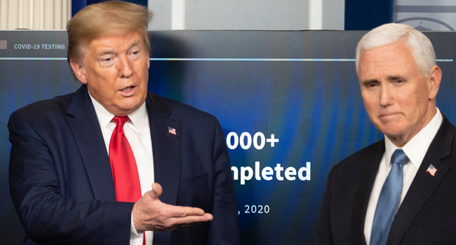 US President Donald Trump (L) gestures to Vice President Mike Pence speaks during the daily briefing on the novel coronavirus, which causes COVID-19, in the Brady Briefing Room of the White House on April 17, 2020, in Washington, DC. JIM WATSON / AFP