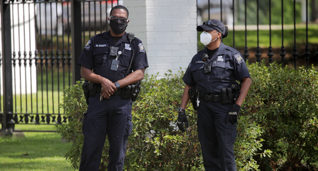 Members of the police stand by as protestors gather outside the Louisiana State Governor's mansion during a rally against Louisiana's stay-at-home order and economic shutdown on April 17, 2020 in Baton Rouge, Louisiana. Chris Graythen/Getty Images/AFP