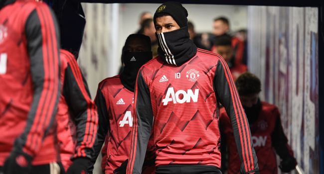 In this file photo taken on December 28, 2019 Manchester United's English striker Marcus Rashford arrives onto the pitch to warm up for the English Premier League football match between Burnley and Manchester United. Oli SCARFF / AFP
