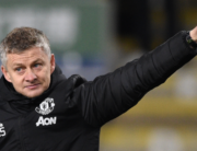 In this file photo taken on December 28, 2019 Manchester United's Norwegian manager Ole Gunnar Solskjaer salutes the travelling Manchester United fans at the end of the English Premier League football match between Burnley and Manchester United at Turf Moor in Burnley. Oli SCARFF / AFP