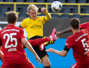 Dortmund's German forward Julian Brandt (C) vies for the ball with (L-R) Bayern Munich's Canadian midfielder Alphonso Davies, Bayern Munich's German forward Thomas Mueller, Bayern Munich's French defender Benjamin Pavard and Bayern Munich's German defender Jerome Boateng during the German first division Bundesliga football match BVB Borussia Dortmund v FC Bayern Munich on May 26, 2020 in Dortmund, western Germany. Federico GAMBARINI / POOL / AFP