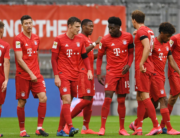 Bayern Munich's Canadian midfielder Alphonso Davies (4thR) celebrates scoring his team's fourth goal with teammates during the German first division Bundesliga football match between FC Bayern Munich and Eintracht Frankfurt on May 23, 2020 in Munich, southern Germany. ANDREAS GEBERT / POOL / AFP