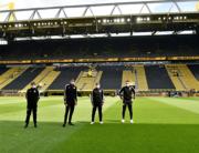 Referee Deniz Aytekin, 2nd left, and his team stand on the pitch prior the German first division Bundesliga football match BVB Borussia Dortmund v Schalke 04 on May 16, 2020 in Dortmund, western Germany as the season resumed following a two-month absence due to the novel coronavirus COVID-19 pandemic. Martin Meissner / POOL / AFP