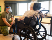 In this image obtained from Canadian Armed Forces Combat Camera, a Canadian soldier aids a senior citizen on May 10, 2020, at the Vigi Queen Elizabeth Residential and Long-Term Care Centre in Montreal, Quebec. Genevieve Beaulieu / Canadian Armed Forces / AFP