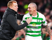 In this file photo taken on November 28, 2019 Celtic's Scottish head coach Neil Lennon (L) congratulates Celtic's Scottish midfielder Scott Brown (R) as he comes off during the UEFA Europa League group E football match between Celtic and Rennes at Celtic Park stadium in Glasgow, Scotland. ANDY BUCHANAN / AFP