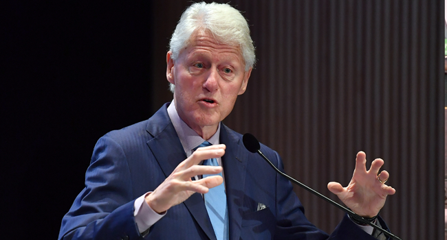 In this file photo former US President Bill Clinton speaks at the fifth annual Town & Country Philanthropy Summit on May 9, 2018 at Hearst Tower in New York City. ANGELA WEISS / AFP