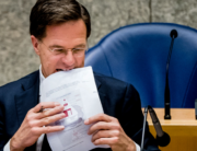 Dutch Prime Minister Mark Rutte holds documents during a parliamentary debate on the coronavirus crisis (COVID-19), in The Hague, on May 20, 2020. Bart MAAT / ANP / AFP
