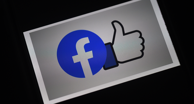 In this file illustration photo taken on March 25, 2020, a Facebook App logo is displayed on a smartphone in Arlington, Virginia. Olivier DOULIERY / AFP