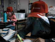 Primary school pupils attend a class wearing protective visor caps made by the city council in La Grand-Croix, near Saint-Etienne, central France, on May 12, 2020. JEAN-PHILIPPE KSIAZEK / AFP