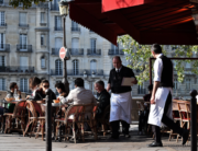In this file photo taken on October 11, 2016 People have lunch at the terrasse of a restaurant in Paris. Bars and restaurants will reopen progressively in France from June 2, as the country enters phase 2 of its novel coronavirus' (COVID-19) lockdown easing. CHRISTOPHE ARCHAMBAULT / AFP