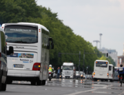 Coaches drive towards Berlin's landmark the Victory Column as travel agency workers demonstrate on May 13, 2020. Odd ANDERSEN /AFP