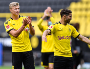 Dortmund's Norwegian forward Erling Braut Haaland (L) claps hands to the empty tribune after winning the German first division Bundesliga football match BVB Borussia Dortmund v Schalke 04 on May 16, 2020 in Dortmund, western Germany. Martin Meissner / POOL / AFP