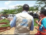 A UNHCR official inspects a scene.
