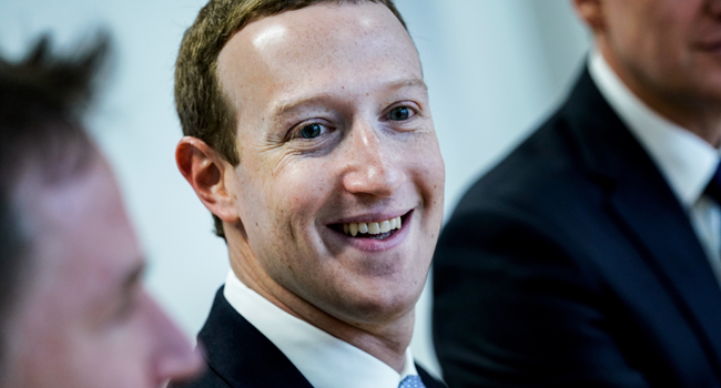 In this file photo Founder and CEO of US online social media and social networking service Facebook Mark Zuckerberg reacts upon his arrival for a meeting with European Commission vice-president in charge for Values and Transparency, in Brussels, on February 17, 2020. Kenzo TRIBOUILLARD / AFP