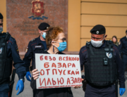 Police officers detain Russian photographer Victoria Ivleva (C) during a solo picket in support of journalist and activist Ilya Azar outside the Moscow police headquarters in Moscow on May 28, 2020. Dimitar DILKOFF / AFP