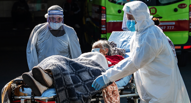 An elderly lady who had been affected by the new COVID-19 coronavirus is discharged from hospital, in Santiago, on May 18, 2020. Martin BERNETTI / AFP