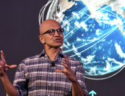 In this file photo taken on February 25, 2020 Microsoft Corporation Chief Executive Officer, Satya Nadella, gestures as he addresses the Future Decoded Tech Summit in Bangalore. Manjunath Kiran / AFP