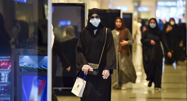 Saudis shop at the Panorama Mall in the capital Riyadh on May 22, 2020, as Muslims prepare to celebrate the upcoming Eid al-Fitr, that marks the end of the fasting month of Ramadan. FAYEZ NURELDINE / AFP