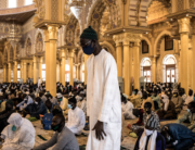 A Muslim worshipper prays before Friday prayers at the Mosque of the Mourides, which open for its first Friday prayers after two months in Dakar on May 15, 2020. JOHN WESSELS / AFP