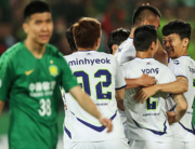 In this file photo taken on May 7, 2019, Jeonbuk Hyundai Motors players celebrate scoring a goal during the AFC Champions League group stage football match between China's Beijing Guoan and South Korea's Jeonbuk Hyundai Motors in Beijing. STR / AFP