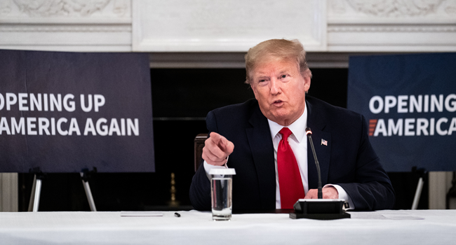 U.S. President Donald Trump speaks during a meeting with industry executives on the reopening of the U.S. economy in the State Dining Room May 29, 2020 in Washington, DC. Erin Schaff-Pool/Getty Images/AFP