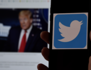 In this photo illustration, a Twitter logo is displayed on a mobile phone with President Trump's Twitter page shown in the background on May 27, 2020, in Arlington, Virginia. Olivier DOULIERY / AFP