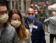A trader walks in front of the New York Stock Exchange (NYSE) on May 26, 2020 at Wall Street in New York City. Johannes EISELE / AFP