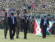 Evariste Ndayishimiye (3rd R), Burundi's elected President from the ruling party, the National Council for the Defense of Democracy - Forces for the Defense of Democracy (CNDD-FDD), walks in front of members of Burundi's army during the swearing-in ceremony at Ingoma stadium in Gitega, Burundi, on June 18, 2020. - Ndayishimiye rapidly sworn in following the sudden death of President Pierre Nkurunziza, aged 55, came after the May election. (Photo by TCHANDROU NITANGA / AFP)