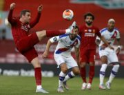 Liverpool's English midfielder Jordan Henderson (L) clears the ball during the English Premier League football match between Liverpool and Crystal Palace at Anfield in Liverpool, north west England on June 24, 2020. (Photo by PHIL NOBLE / POOL / AFP) / RESTRICTED TO EDITORIAL USE. No use with unauthorized audio, video, data, fixture lists, club/league logos or 'live' services. Online in-match use limited to 120 images. An additional 40 images may be used in extra time. No video emulation. Social media in-match use limited to 120 images. An additional 40 images may be used in extra time. No use in betting publications, games or single club/league/player publications. /