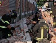 A photo grabbed from a video taken and handout on June 24, 2020 by the Italian Corps of Firefighters (Vigili del Fuoco) shows an Urban Search And Rescue team working at the site of a building collapse in Albizzate, near Varese, northern Italy, that killed a woman and her two children who were walking along the building's wall. (Photo by Handout / Vigili del Fuoco / AFP) /