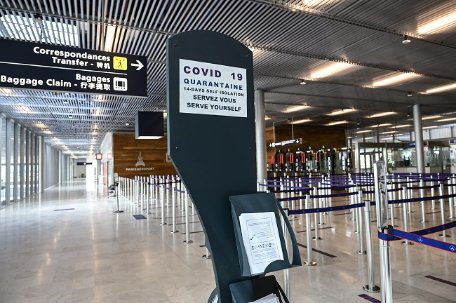 A photograph taken on June 22, 2020, shows an information board for travelers in the arrival area of the Terminal 3 at the Orly airport, in Orly on the outskirts of Paris, a few days before its reopening as France eases lockdown measures taken to curb the spread of the COVID-19 (the novel coronavirus). - The airport should reopen on June 26, 2020 after being closed as part of the measures adopted by French government to fight against the COVID-19 pandemic. (Photo by BERTRAND GUAY / AFP)