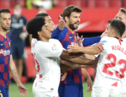 Barcelona's Spanish defender Gerard Pique (C) argues with Sevilla's Spanish defender Sergio Reguilon (R) during the Spanish league football match between Sevilla FC and FC Barcelona at the Ramon Sanchez Pizjuan stadium in Seville on June 19, 2020. CRISTINA QUICLER / AFP