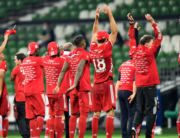 Bayern's players celebrate after the German first division Bundesliga football match SV Werder Bremen v FC Bayern Munich on June 16, 2020 in Bremen, northern Germany. Martin MEISSNER / POOL / AFP