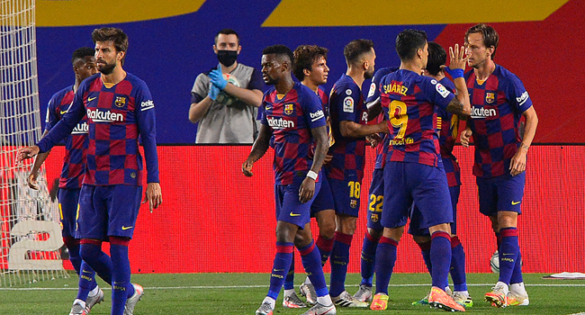 Barcelona's players celebrate after scoring a goal during the Spanish league football match between FC Barcelona and Athletic Club Bilbao at the Camp Nou stadium in Barcelona on June 23, 2020. Pau BARRENA / AFP