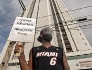 "A demonstrator holds a sign reading ""Black Lives Matter"" in demand of justice for the death of five-year-old Miguel Otavio Santana da Silva, the son of a black maid who on June 2 fell from the ninth floor of a building while under the watch of his mother's white employer, in Recife, Pernambuco State, in northeastern Brazil, on June 5, 2020. Leo Malafaia / AFP"