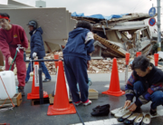 Earthquake refugees gather at a water source on a street of Kobe's Nada area on February 16, 1995 following the Great Hanshin Earthquake nearly one month ago. Kazuhiro NOGI / AFP