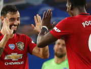 Manchester United's Portuguese midfielder Bruno Fernandes (L) celebrates scoring their second goal with Manchester United's French midfielder Paul Pogba (R) during the English Premier League football match between Brighton and Hove Albion and Manchester United at the American Express Community Stadium in Brighton, southern England on June 30, 2020. Alastair Grant / POOL / AFP