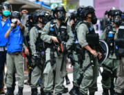 In this file photo taken on May 24, 2020, riot police gather on a road as protesters take part in a pro-democracy rally against a proposed new security law in Hong Kong. Anthony WALLACE / AFP