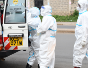 Kenya Redcross paramedics wearing personal protective equipment (PPE) prepare to assist a COVID-19 coronavirus patient that is inside the ambulance before taking him to the hospital, in Nairobi June on 3, 2020. Simon MAINA / AFP