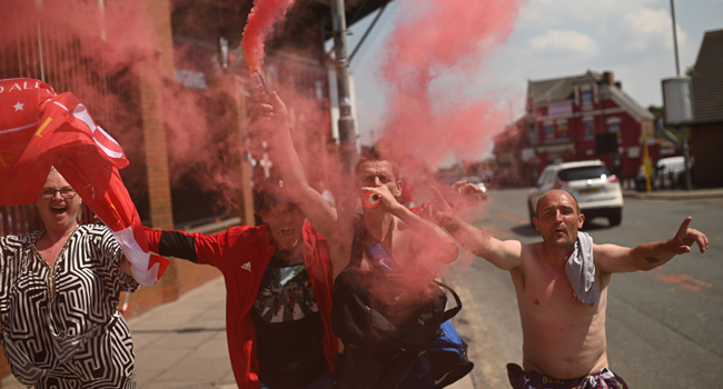 Liverpool fans celebrate victory outside Anfield stadium in Liverpool, north west England on June 26, 2020 after Liverpool FC sealed the Premier League title the previous evening. Oli SCARFF / AFP