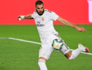 Real Madrid's French forward Karim Benzema eyes on the ball prior to shooting and scoring his second goal during the Spanish league football match between Real Madrid CF and Valencia CF at the Alfredo di Stefano stadium in Valdebebas, on the outskirts of Madrid, on June 18, 2020. JAVIER SORIANO / AFP