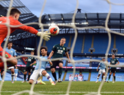 Manchester City's Spanish midfielder David Silva scores the fourth goal past Burnley's English goalkeeper Nick Pope during the English Premier League football match between Manchester City and Burnley at the Etihad Stadium in Manchester, north west England, on June 22, 2020. Michael REGAN / POOL / AFP