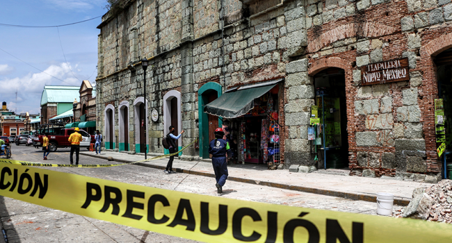 Security tape alerts people of a damaged building after a quake in Oaxaca, Mexico on June 23, 2020. A 7.1 magnitude quake was registered Tuesday in the south of Mexico, according to the Mexican National Seismological Service. PATRICIA CASTELLANOS / AFP